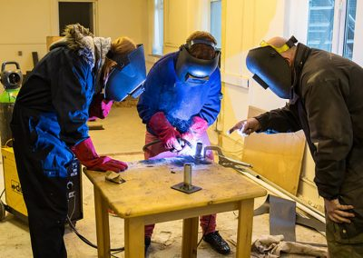 The-Friendship-Cafeyoung people learning to weld